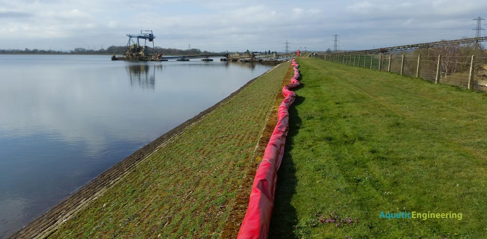 Oil Boom on grass verge installed by Aquatic Engineering