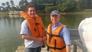 Tiago of Hydroscience and Nigel of Phoslock on Lake Pampulha Brazil shaking hands