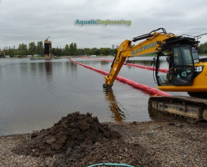 Digger assisting with Strathclyde Biological Barrier Installation